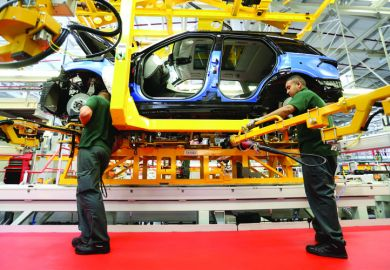 Production line employees working on Range Rover