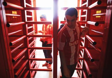 Supporters enter the ground through the turnstiles prior to the Barclays Premier League match between Stoke City and Norwich City at the Britannia Stadium in Stoke on Trent, England