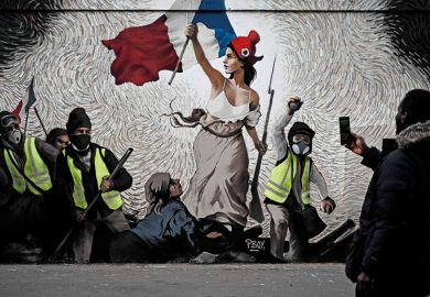 "A man takes a picture of a mural by street artist PBOY depicting Yellow Vest (gilets jaunes) protestors inspired by ""La Liberte guidant le Peuple"" painting by Eugene Delacroix in Paris on January 8, 2019"