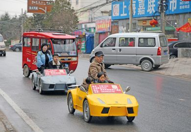A farmer and his wife drive his miniature home-made Lamborghini. China