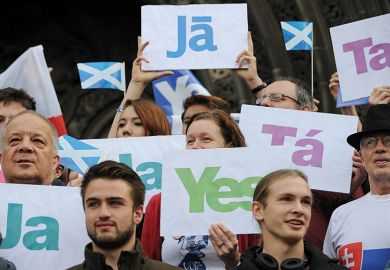 Leaflets with the word 'Yes' written in different languages are displayed. Scottish referendum, 2014.