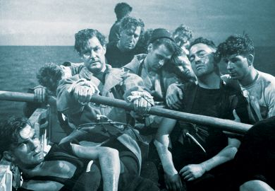 1945:  Torpedoed in the Mediterranean sea, Robert Donat (rowing) and the crew take to the life boats. Alf Goddard is in the background, and Harry Ross is second from left. From the film 'Perfect Strangers', directed by Alexander Korda for London Films.