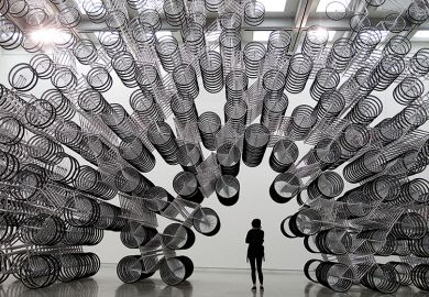 A woman looks at an art installation of bicycles in Taipei October 28, 2011