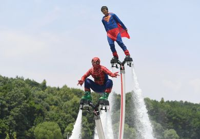 Motorboat athletes dressed as superman and spiderman compete on Tongsheng Lake on July 14, 2017 in Changsha, Hunan Province of China