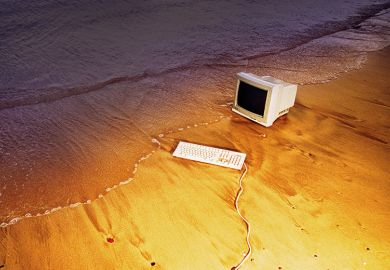 Old computer on beach