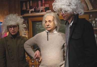 Two men in wigs with waxwork of Albert Einstein