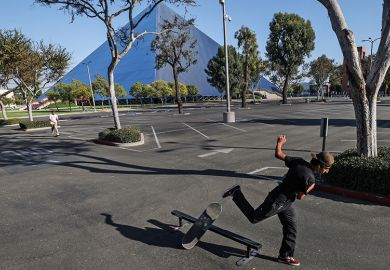Long Beach, CA, Monday, September 29, 2020 - man skateboards in an empty parking lot at Cal State Long Beach where five students tested positive for Covid-19.
