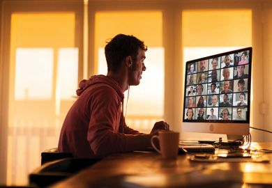 Man looking at computer screen with video conferencing