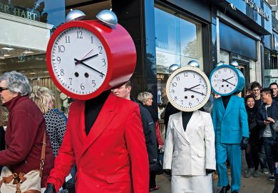 Three people dressed in red, white and blue suits with clocks for heads
