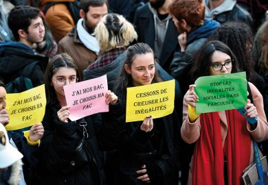 """Students hold banners reading """"I passed my high school diploma (Baccalaureat or Bac in French), I get to choose my university"""" and """"Stop widening inequalities"""" during a demonstration march at Place Saint-Michel, Paris, France, on December 11, 2018"""