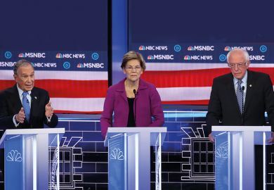 Democratic presidential candidate former New York City Mayor Mike Bloomberg, speaks as Sen. Elizabeth Warren (D-MA) and Sen. Bernie Sanders (I-VT) listen during the Democratic presidential primary debate at Paris Las Vegas on February 19, 2020.