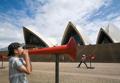 Kids shout through megaphones at the Opera House during the Sydney Festival. Australia