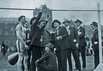 Officials measuring the high jump