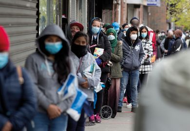 Citizens wearing protective masks form lines to receive free food from a food pantry run by the Council of Peoples Organization on May 8, 2020 in the Midwood neighborhood of Brooklyn, New York.