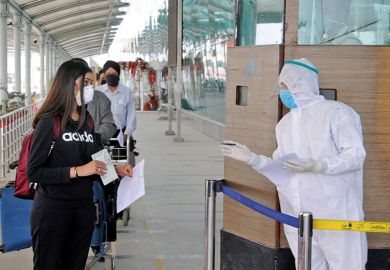 Checking passports during the coronavirus pandemic