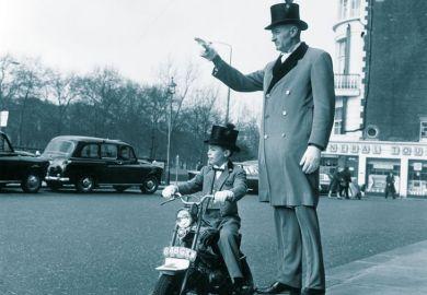 Man with boy on bike