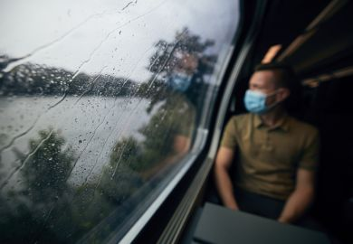 Passenger on a train wearing a face mask