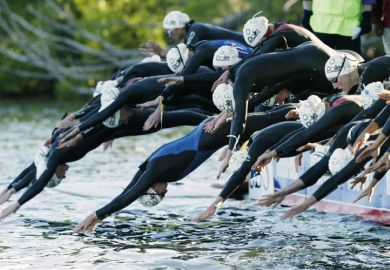 Triathlon swimmers at the start of a race