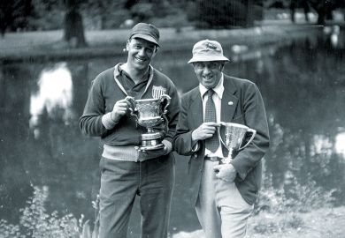 Two men with trophies