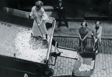 Woman sweeping coins into a wheelbarrow