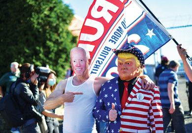 Trump supporters wearing a cardboard cut out of Democratic presidential nominee Joe Biden and a mask of Donald Trump embrace after Biden named winner in the 2020 U.S. presidential election, Philadelphia