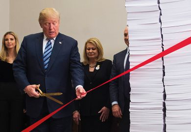 Former US president Donald Trump cutting ribbon