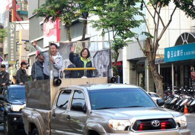 Tsai Ing-wen waves to supporters ahead of the 2016 presidential election