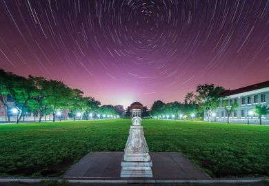 Star trails over Tsinghua University in China