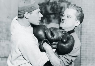 Two boxers tussling during fight