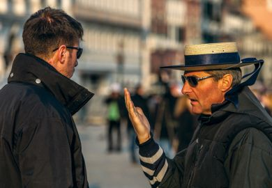 Two male gondoliers speaking, Piazza San Marco, Venice, Italy