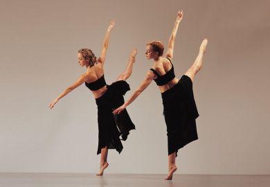 Two women dancing side by side
