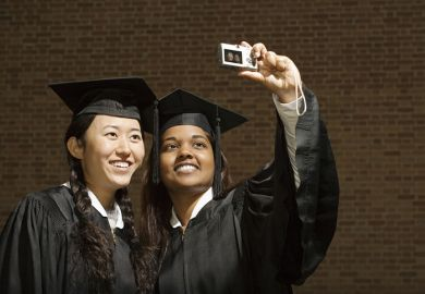 Two female graduates taking a photograph