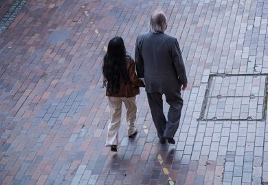 A man and a woman walking in the street