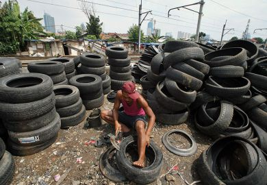 Man with tyres