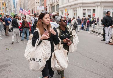 Woman carries Uber-branded bag