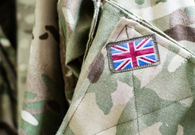 Union Jack flag on sleeve of British military camouflage uniform