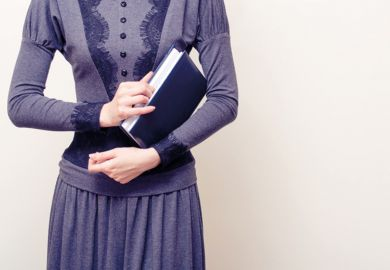 Victorian woman holding book