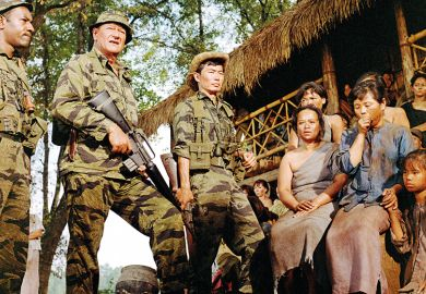 John Wayne (second from left) as Colonel Mike Kirby, and George Takei (centre) as Captain Nim, in 'The Green Berets', directed by John Wayne, Ray Kellogg and Mervyn LeRoy, 1968