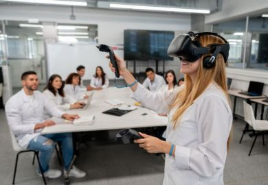 A student uses virtual reality headset in the classroom
