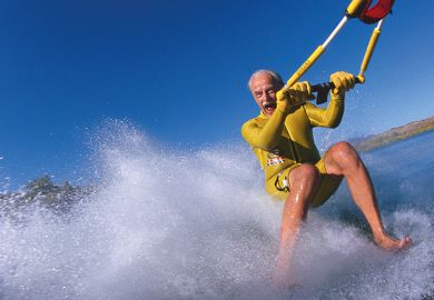 Older man waterskis