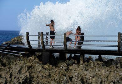 People splashed with big wave