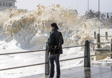 Strong winds blow large puffs of foam off the sea and into the streets of Sea Point in 2020 in Cape Town, South Africa