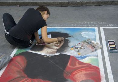 woman draws portrait on pavement with crayons