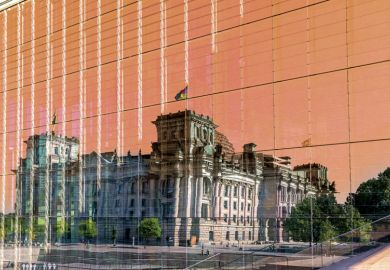 Reichstag building mirrored in glass as a metaphor to plagiarism scandals relating to politicians.