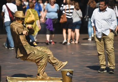 A street artist performs for the public in Sydney