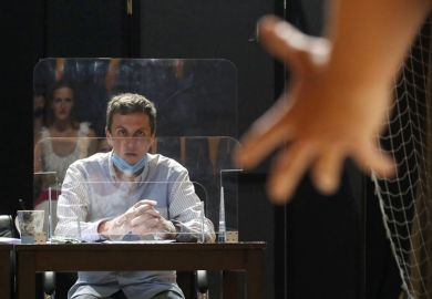 Person behind a screen during entrance auditions for the Acting Department of the Russian University of Theatre Arts
