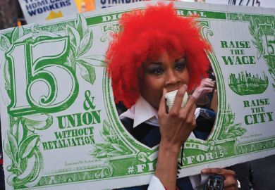 Person with red wig dressed as a fake banknote as a metaphor for US colleges face tougher scrutiny on graduate employment
