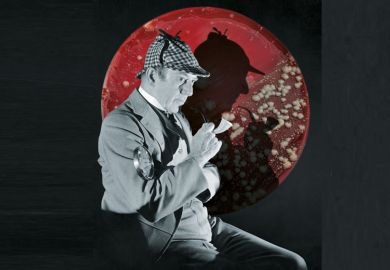 Studio portrait of a man dressed as British detective Sherlock Holmes with a plaid cap, a meerschaum pipe, and a magnifying glass. His silhouette is visible in the background