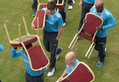 England  team carry back their chairs after a team photo.