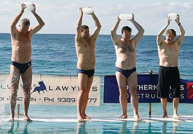 People carry ice blocks as they prepare to get into the pool next to the Pacific Ocean at Bondi Beach in Sydney.